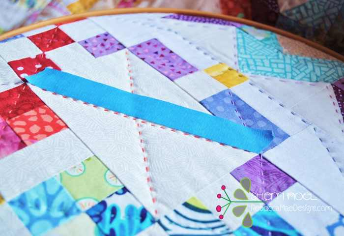If you are quilting a long straight line and need a 'guide' try using painters tape and just stitch along side of it!  It helps and the tape pulls right off and you can use it a couple more times before the 'stick' is worn out.