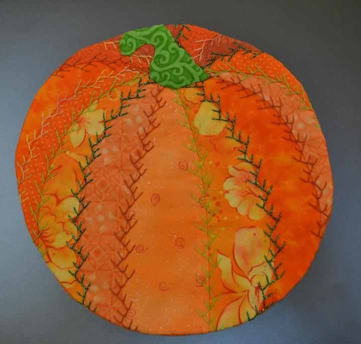 embroidered pumpkin mug rug