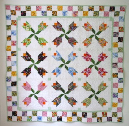 Free Quilting Patterns For Spring : Scrappy Spring Tulips in Two Block Sizes - Quilting Digest