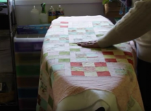 Easily Baste a Quilt on Your Ironing Board