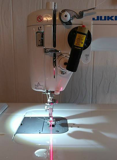 Simplify Piecing and Quilting with a Retrofitted Laser Guide