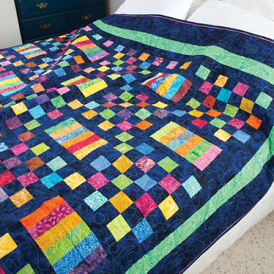 Navy Makes Colorful Batiks Pop In This Colorful Quilt