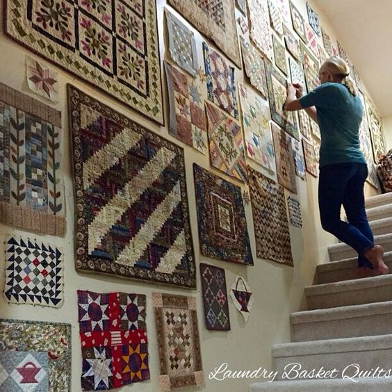 Edyta Sitar and Wall of Mini Quilts