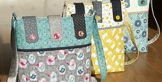Button Tab Messenger Bag