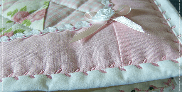 Quilt with Binding Secured with a Deorative Stitch